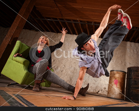 Dancer Leaping Up stock photo, Agile young male break dancer leaping up by Scott Griessel