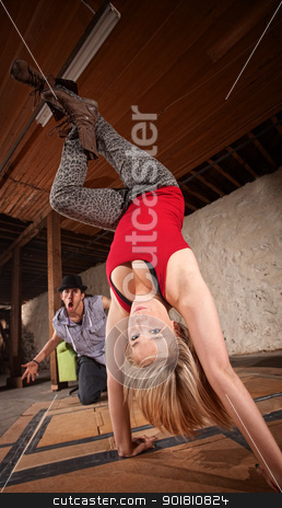Female Dancer in Hand Stand stock photo, Attractive young European break dancer standing on her hands by Scott Griessel