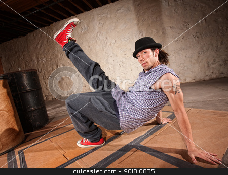 Male Urban Dancer stock photo, Handsome Latino male with leg up while break dancing by Scott Griessel