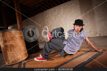 Man Break Dancing stock photo, Handsome Mexican man performs break dancing moves by Scott Griessel