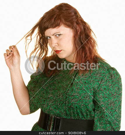 Woman Plays With Her Hair stock photo, Beautiful European red head plays with her hair by Scott Griessel