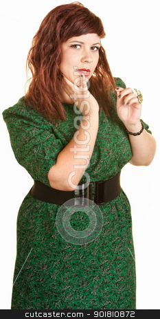 Beautiful Woman Plays With Hair stock photo, Pretty young European plus size woman with hand on chin by Scott Griessel