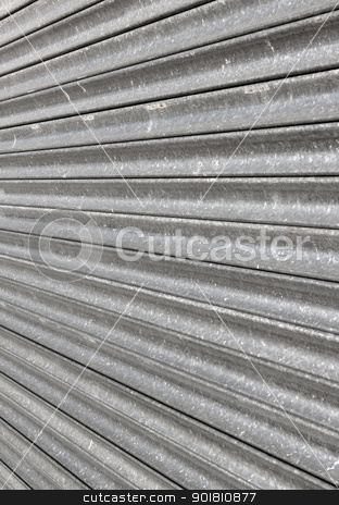 Closed metal shop security shutter close up. stock photo, Closed metal shop security shutter close up. by Stephen Rees