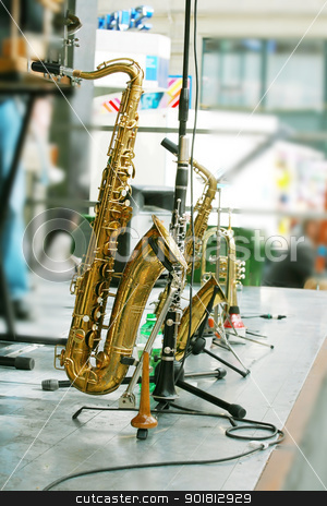 golden saxophone alto on stage  stock photo, golden saxophone alto on stage   by dacasdo
