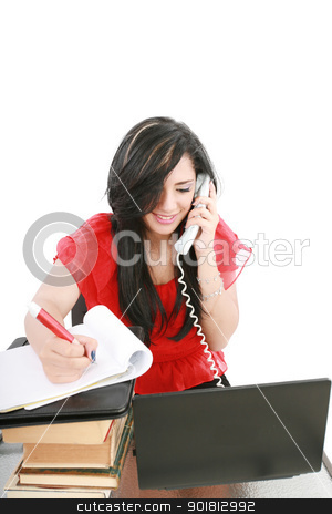 Smiling young business woman on phone taking notes in office  stock photo, Smiling young business woman on phone taking notes in office  by dacasdo