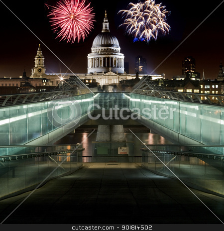 St. Paul's Cathedral and Fireworks stock photo, A view of St. Paul's Cathedral from the Millennium Bridge and fireworks in the background. by Chris Dorney
