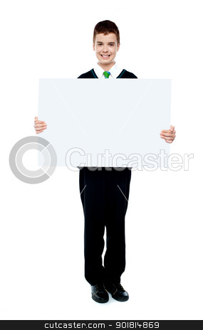 Young boy showing blank billboard stock photo, Young boy showing blank billboard against white background by Ishay Botbol   