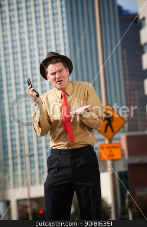 Upset Man With Phone stock photo, Unhappy Caucasian businessman with mobile phone on street by Scott Griessel