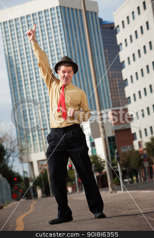 Happy Businessman stock photo, Happy Caucasian businessman points index finger upward by Scott Griessel
