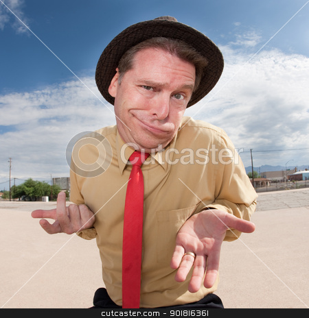 Innocent Businessman stock photo, Caucasian businessman in hat with open hands outside by Scott Griessel