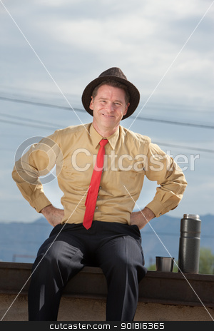 Smiling Businessman stock photo, Smiling Caucasian businessman relaxes with hands on hips by Scott Griessel
