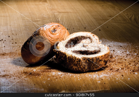 Tasty rolls with a poppy stock photo, Tasty rolls with a poppy lying on a wooden table by Vadim
