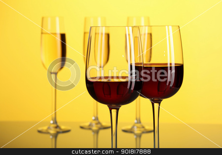 Glasses with wine stock photo, Glasses with wine on the color background by Sergey Nivens