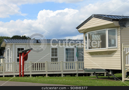 Mobile caravans or trailers in modern holiday park stock photo, Mobile caravans or trailers in modern holiday park.  by Martin Crowdy