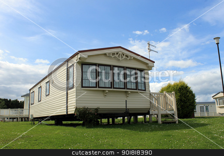 Modern static caravan stock photo, Modern static caravan on campsite during summer, holiday or vacation scene. by Martin Crowdy