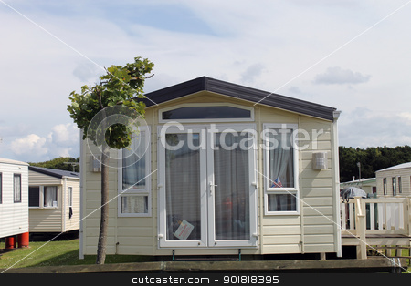 Modern static caravan on campsite stock photo, Modern static caravan on campsite during summer, holiday or vacation scene. by Martin Crowdy