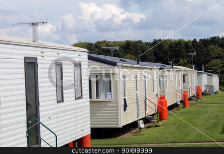 Modern static caravans stock photo, Modern static caravans on campsite during summer, holiday or vacation scene. by Martin Crowdy