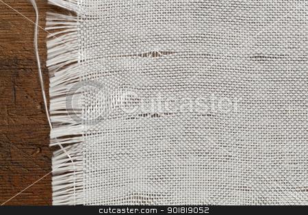 woven fiberglass cloth stock photo, edge of woven fiberglass cloth on a grunge wood background by Marek Uliasz