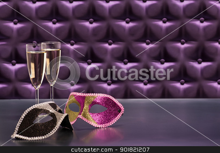 New Years celebration items stock photo, New Years celebration items in front of a button tufted purple silk background by Ulrich Schade