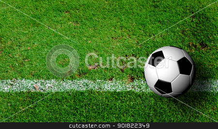 Soccer Ball on green grass field from top view stock photo, Soccer Ball on green grass field from top view by jakgree