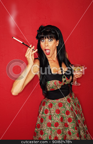 Excited Woman  stock photo, Excited woman with Martini and cigarette over maroon background by Scott Griessel