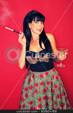 Woman Enjoys A Drink stock photo, Woman over maroon background enjoys cigarette and martini  by Scott Griessel