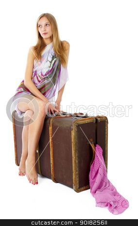 Young woman with suitcase stock photo, Young beautiful blonde with suitcase at white background by Aikon