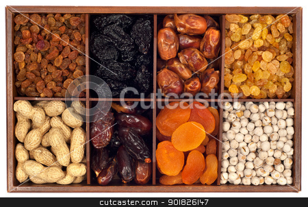 Dried fruits stock photo, Assorted dried fruits in wooden box,isolated on white background.Raisin,prune,date,monkey-nut, apricot,nuts by borojoint