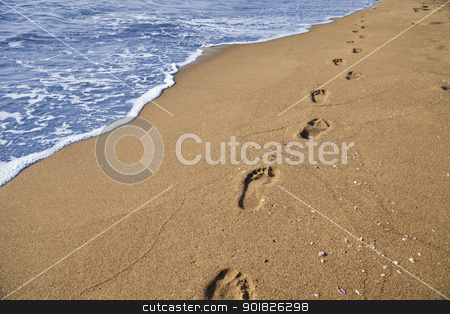 Footsteps stock photo, Footsteps of a man who walks on the beach by the sea by Alfio Roberto Silvestro