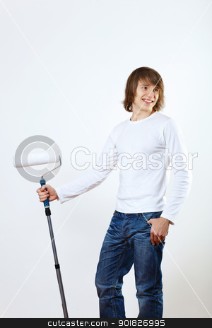Man with paint brushes stock photo, Portrait of young man with paint brushes by Sergey Nivens