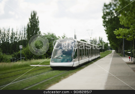 Tramway in Strasbourg stock photo, Modern tramway passing near the European Parliament in strasbourg, France. Tilt shift lens used to accent the moving tramway and to emphasize the motion. by ifeelstock