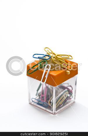 Colorful container for paper clips stock photo, Colorful plastic coated paper clips in clear innovative container with magnet, isolated on white background by Gandolfo Cannatella