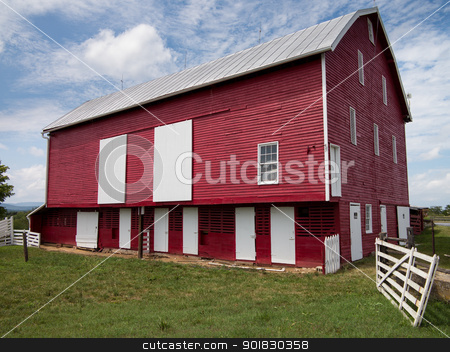 Traditional US red painted barn on farm stock photo, Red painted wooden barn with white door on farm in traditional US style by Steven Heap