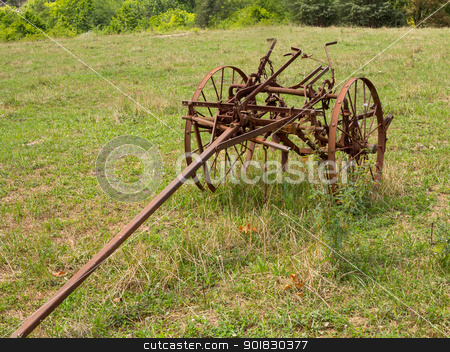 Unused and rusted farm plow in field stock photo, Rusted farm plow or plough pulled by horse in a field on farm by Steven Heap