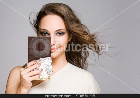 Chocolate loving brunette cutie. stock photo, Portrait of a sensual chocolate loving brunette cutie. by exvivo