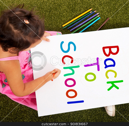 Girl Writing Back To School As Symbol For Education stock photo, Girl Writing Back To School As A Symbol For Education by stuartmiles