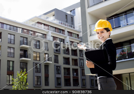 Female construction engineer show building stock photo, Female construction engineer show building in background by fikmik