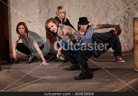 Four Hip Teens in Stylish Pose stock photo, Female dancer and friends posing in underground setting by Scott Griessel