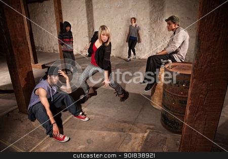 Break Dancer Showing Off stock photo, European hip hop dancer posing as friends watch by Scott Griessel