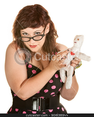 Woman With Glasses and Voodoo Doll stock photo, Pretty woman in pink polka dot dress with voodoo doll by Scott Griessel