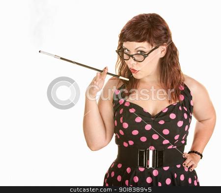 Lady in Polka Dot Dress Smoking stock photo, Smirking woman in pink polka dot dress holding cigarette by Scott Griessel