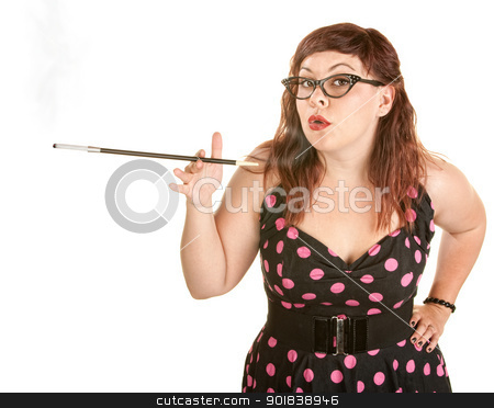 Woman Blowing Smoke Rings stock photo, Beautiful woman in pink polka dot with cigarette holder by Scott Griessel