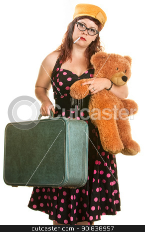 Tired Woman with Suitcase and Toy stock photo, Tired woman in polka dot dress with teddy bear and suitcase by Scott Griessel