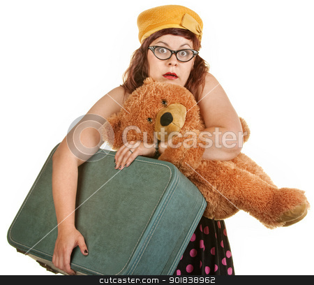 Tense Young Woman with Suitcase stock photo, Tense young woman with toy bear and suitcase by Scott Griessel