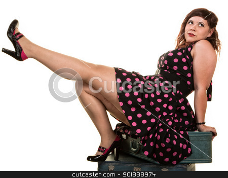 Flirtacious Woman Showing Off Her Leg stock photo, Flirtacious Caucasian woman on suitcases kicking her leg by Scott Griessel