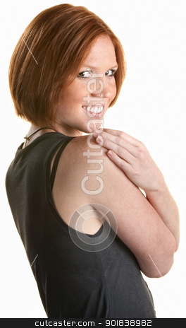 Satisfied Happy Woman stock photo, Smiling red haired woman holding her shoulders by Scott Griessel