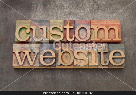 custom website  stock photo, custom website - text in vintage letterpress printing blocks against a grunge metal sheet by Marek Uliasz