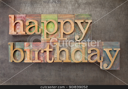 happy birthday in wood type stock photo, happy birthday - text in vintage letterpress printing blocks against a grunge metal sheet by Marek Uliasz