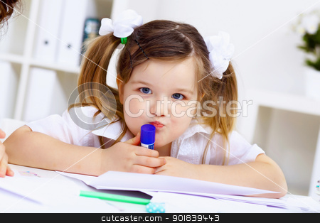 Little girl and her mother studying stock photo, Young mother and her little girl studying together at home by Sergey Nivens