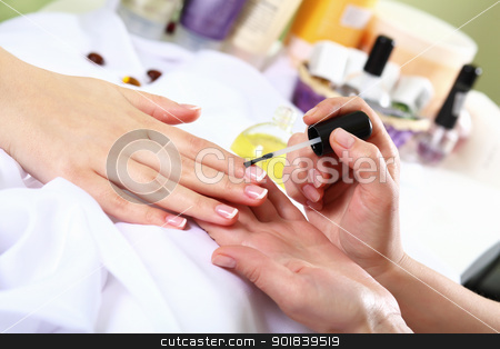 Female hands and manicure related objects stock photo, Female hands and manicure related objects in spa salon by Sergey Nivens